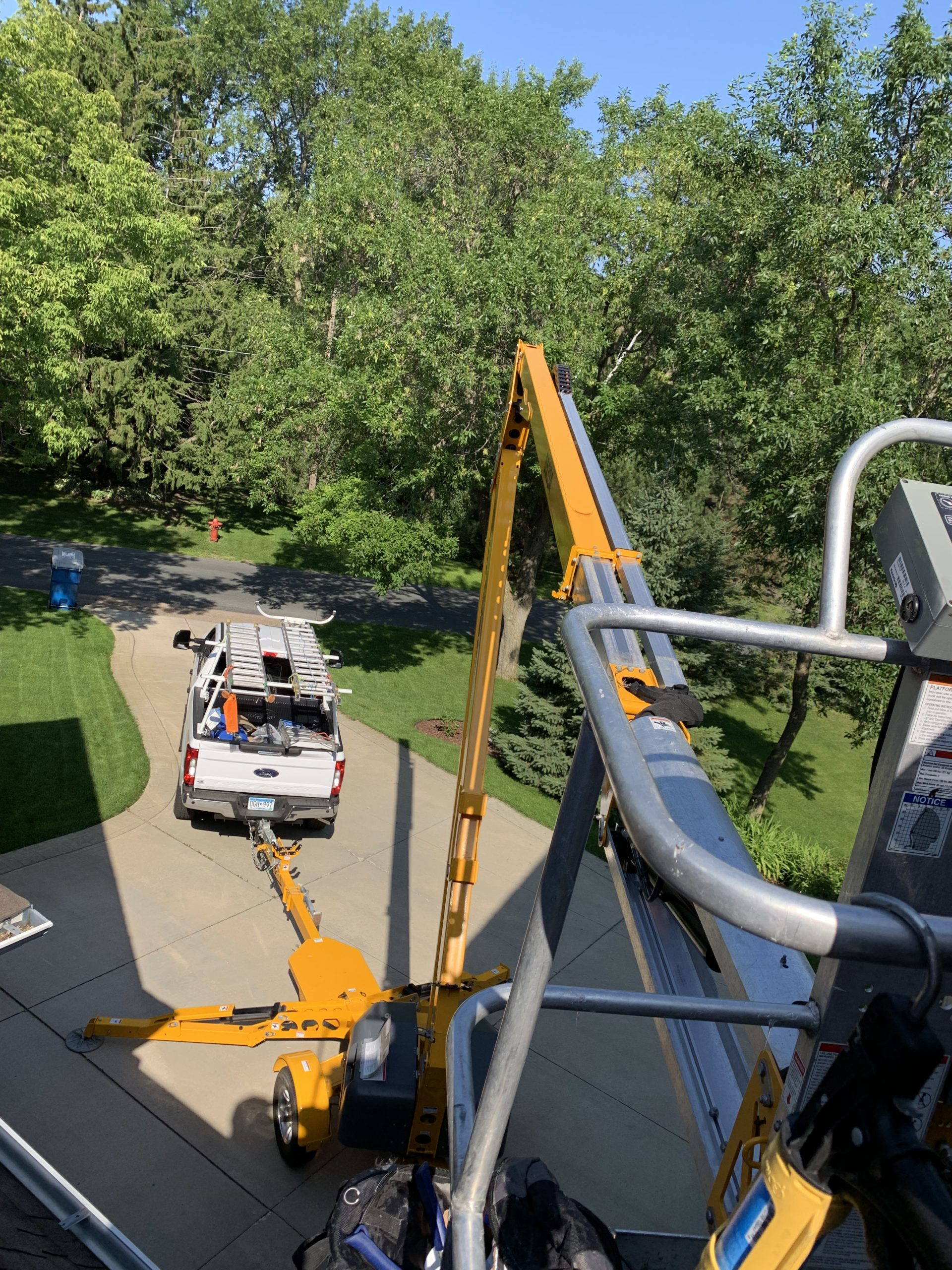 Bat Free uses an aerial lift to access high parts of a home.